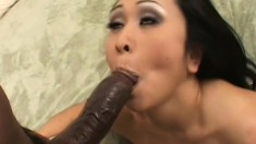 Lustful Asian cougar has a black stud fulfilling her sexual fantasies