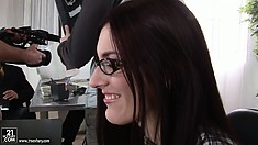 Admirable girl in glasses is tempted and fucked in the office room