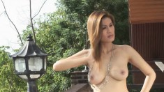 Mesmerizing Kat Naponya shows off her impressive attributes outside