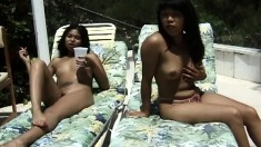 Tammie enjoys relaxing naked in the sun with her stunning friend