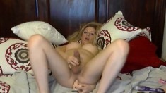 Buxom tranny stuffs a dildo inside her butt and strokes her big dick