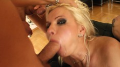 Stacked blonde cougar Vinnie has two guys punishing her holes at once