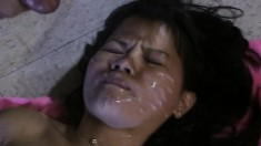 Sexy slim Oriental chick gets her beautiful face covered in hot semen