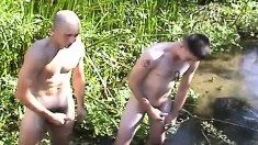 Three beautiful and horny soldiers masturbate together in the outdoors