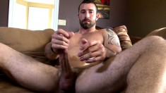 Beautiful hunk Vinny Castillo lies on the couch and makes himself cum