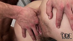 She screams as he fucks her tight ass and fingers her hairy pussy