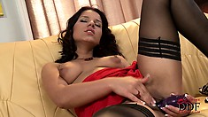 Latina in stockings rubs her hairy cunt while dildoing herself