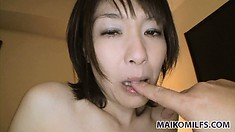 In the bathtub, the cute Asian lady puts into action her amazing oral attributes