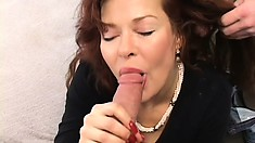 Busty redhead milf can't hide her excitement for having two young studs banging her twat
