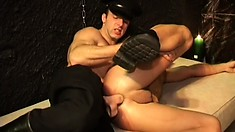 Gay fetish scene with guards and prisoners eating meat and fucking ass