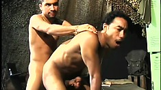 Two ripped studs enjoy sucking on each other's thick sausages