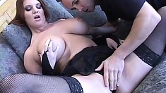 Big breasted redhead mom in black stockings wildly rides a stiff cock