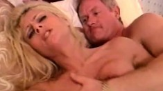 Sexy blonde milf in black boots Danielle Kelson gets fucked on the bed