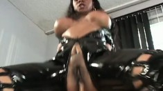 Black babe in latex takes some rough pounding from a dick and a toy