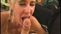 Cute blonde slut gets her face stuffed by a younger man's dick