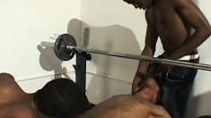 Dark-skinned guys fuck cute white dude with huge dick in gym