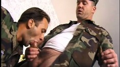 Muscular army officer bends over to receive some fresh young cock