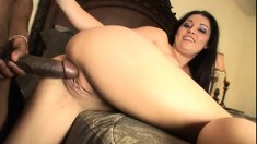 Striking young brunette with wonderful tits fucks a huge black stick