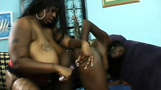 Lusty black hooker rubs and licks the wet pussy lips of her girl