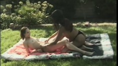 Ebony beauties indulging in passionate lesbian action in a public park