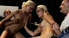 Two uninhibited girls take on four horny fuckers in this hot orgy