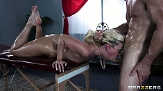 This oily babe gets fucked rough on the edge of a massage table