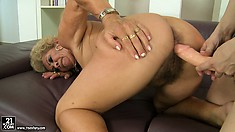 The blonde cougar gets her hairy pussy drilled by the strap-on dildo and loves it