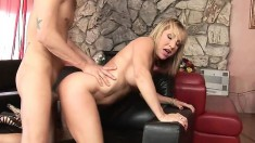 Exciting blonde mom with big hooters indulges in hot sex on the couch