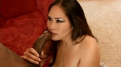 Asian cocksucker Jessica Bangkok gives head and plays with a cock