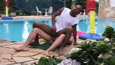 Interracial lovers take turns drilling each other's asses by the pool