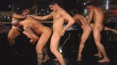 Gorgeous and lustful young studs engage in a wild gay orgy in the club