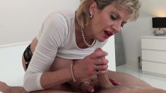 Big breasted blonde wife sends her skillful hands pleasing a huge dick