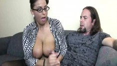 Stacked housewife pleases a young man's big dick with her gifted hands