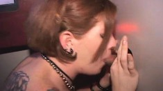 Tattooed redhead with big boobs puts her blowjob skills into action