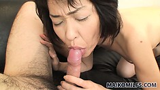 Lustful and excited, the Asian lady fingers her wet pussy while sucking his shaft