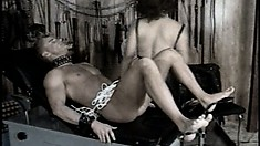 Mistress ties down her male slave's cock and balls to his ankles