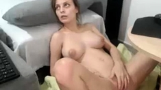 Busty brunette bitch plays with sex toys on the webcam