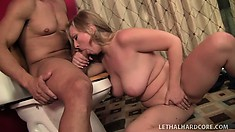 Curvy blonde touches herself while sucking on a fat love stick