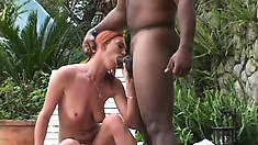 Eager redhead enjoys being pounded by a hung black guy outdoors