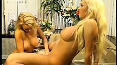 These two busty blonds take turns fucking with the fake cock
