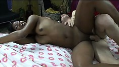 Sexy black babe parks her wet twat on his face and gobbles his white boner before getting boned