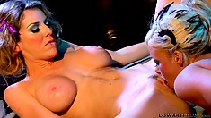 Kayla Paige and Krista Moore rock the house with hot lesbian action