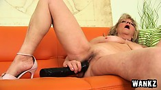 Blonde granny Lotta on the couch showing her saggy body and toying twat