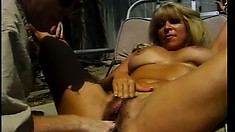 Tanned blonde MILF gets boned by her pool boy on a lounge chair