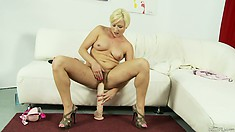 Her hot body quivers with pleasure as she slowly slides those big toys in her cunt