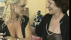 Two lusty mature lesbians enjoy stroking their pussies with toys