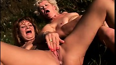 Horny mature ladies finger and taste each other's fiery pussies in the outdoors
