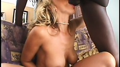 Big breasted blonde milf has a black guy punishing her cunt on the bed