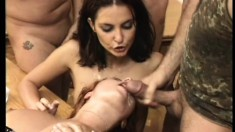 Horny slut takes on a pair of hard cocks while moaning like a freak
