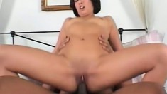 Carmen gets on top of the black stud and wildly fucks his huge prick